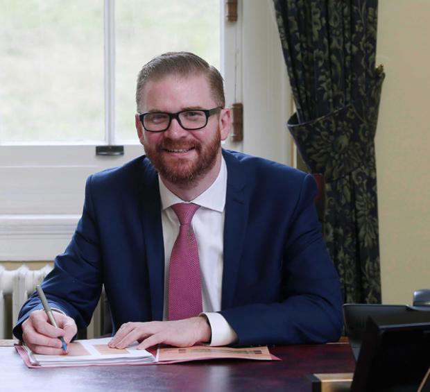 Health Minister Simon Hamilton Official