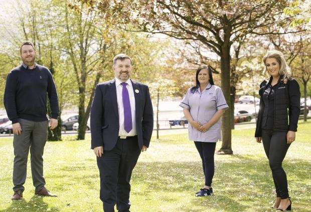 Health Minister Robin Swann with Social Care Workers; James Digney, Slieve Grand Supported Living, Downpatrick; Amanda Godfrey, SE Trust Day Care Support Worker and Stephanie McAleese, Connected Health