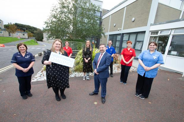 Minister of Health Robin Swann joins Chief Nursing Officer Charlotte McArdle with some graduates at the Trust HQ in Dundonald